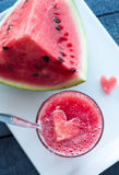 Smoothie in a glass of watermelon on a white plate Royalty Free Stock Photo