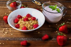 Smoothie with granola berries and mango side view stock photos