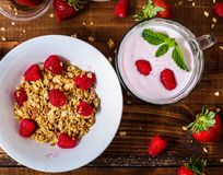 Smoothie with mint on wooden table near granola bowl table top stock photo