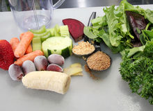 Smoothie Ingredients. Greens, fruits, vegetables, seeds, and nuts for a nutritious breakfast smoothie Stock Photos