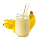 Smoothie in jar with bananas. Banana smoothie in a jar with straws over white, bananas in background Royalty Free Stock Photos