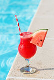 Smoothie juice drink Glass and swimming pool holiday tropical concept Stock Image