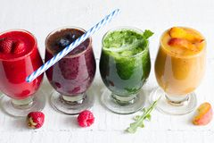 Smoothie juice with healthy fresh raw  fruits and vegetables on white planks Stock Images