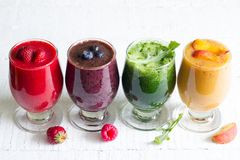 Smoothie juice with healthy fresh raw  fruits and vegetables on white planks Royalty Free Stock Image
