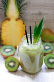Smoothie of kiwi, pineapple and pears. stock image