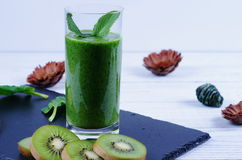 Smoothie kiwi and spinach. Smoothie spinach and kiwi in a black and white background Stock Image