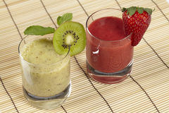 Smoothie of kiwi and strawberry on a straw mat Stock Photo