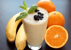 Smoothie made with banana, orange and blueberries fruits Stock Image