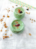 Smoothie made of pears and spinach. With granola for healthy nutrition stock photography