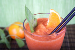 Smoothie with melon and carot. Smoothie with melon, orange, mint and carot stock image