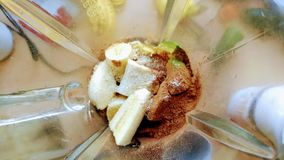 Smoothie Mix. Various fruits and cocoa powder in a mixer, ready to be pureed royalty free stock photo