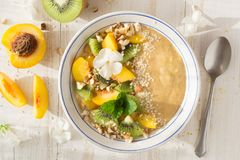 Smoothie with peach, kiwi, nuts. Sesame royalty free stock photography