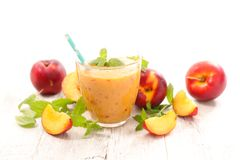 Smoothie with peaches. Fresh smoothie with fresh peaches Stock Images