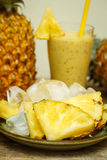 Smoothie with pineapple in glass Royalty Free Stock Images