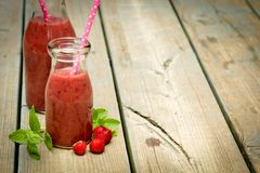 Smoothie on rustic wood Royalty Free Stock Photo