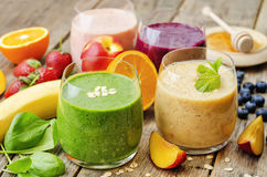 Smoothie with spinach; blueberries, peach and strawberries Royalty Free Stock Photography