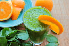 Smoothie with spinach and orange fruit Stock Photography