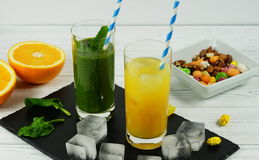 Smoothie spinach  and orange juice. In a black and white background Stock Photo