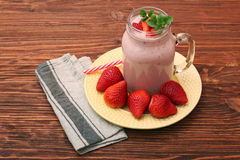 Smoothie with strawberries and milk Royalty Free Stock Photos