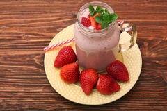 Smoothie with strawberries and milk Royalty Free Stock Images