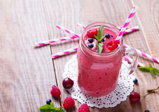 Smoothie with summer berries and fruits in a glass mug Stock Images