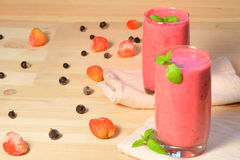 Smoothie on  wooden background Royalty Free Stock Images