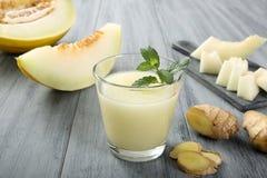 Smoothie y jengibre del melón Imagen de archivo