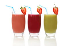 Smoothies. Different flavoured fruit smoothies on a white background royalty free stock image