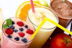 Smoothies. Assorted fruit smoothies close up on white background Royalty Free Stock Photography