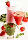 Smoothies. Different smoothies with fruits and vegetables Royalty Free Stock Photos