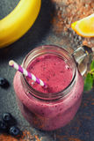 Smoothies with the addition of blueberries Stock Images