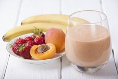 Smoothies with apricot, strawberry and banana Stock Photo