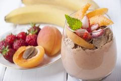 Smoothies with apricot, strawberry, banana and  muesli Royalty Free Stock Image