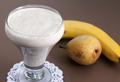 Smoothies of banana and pear. Royalty Free Stock Photography