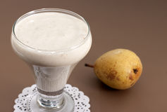 Smoothies of banana and pear. Royalty Free Stock Photos