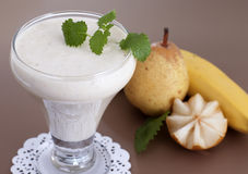 Smoothies of banana and pear. Stock Photo