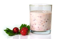 Smoothies with a red gooseberry berry on a white background Stock Image