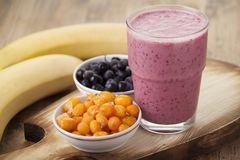Smoothies with buckthorn, blueberries and a banana in a glass Royalty Free Stock Photography