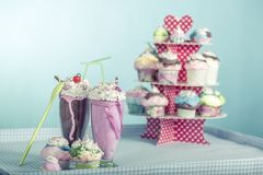 Smoothies and cupcakes. Are smoothies and cupcakes with cream with the style of the sixties stock photos