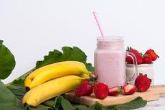 Smoothies del plátano de Strawbeery Imagen de archivo libre de regalías