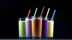 Smoothies. Different fresh fruit and vegetables smoothies in glasses royalty free stock images