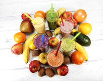 Smoothies. Different fresh smoothies in glasses and fruit stock photos
