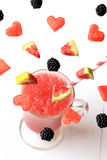 Smoothies with flying fruit and berries fresh Royalty Free Stock Photos
