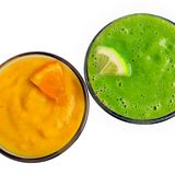 Smoothies of fresh fruit decorated with slices of orange and lim Royalty Free Stock Image