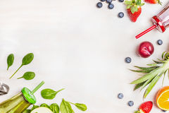 Smoothies and fresh ingredients on white wooden background, top view. Royalty Free Stock Image