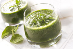 Smoothies. Fresh and tasty spinach smoothies royalty free stock photos