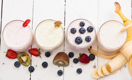 Smoothies. Fruit smoothies with blueberries , strawberry, kiwi and banana royalty free stock photography