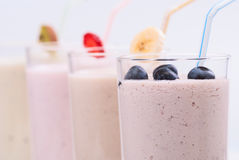 Smoothies. Fruit smoothies with blueberries , strawberry, kiwi and banana royalty free stock photo