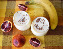 Smoothies of fruit in glasses on a table with a yellow tablecloth Royalty Free Stock Photography