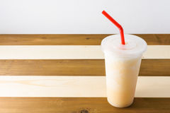 Smoothies of fruit juice. On wooden background with red tube stock photo